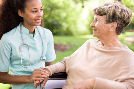 nurse and stethoscope and older person: Senior woman and doctor spending time in the garden Stock Photo
